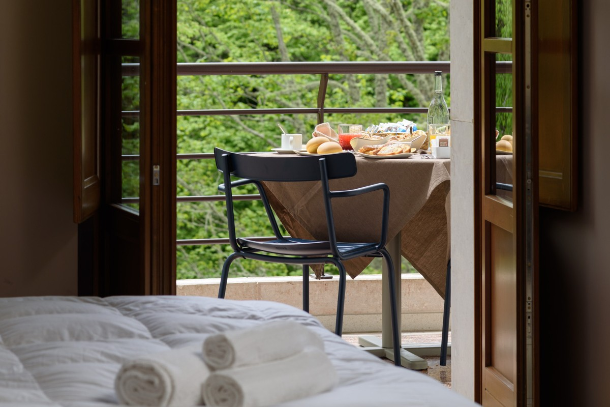 letto singolo accesso terrazzo colazione